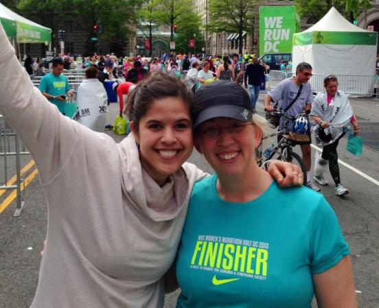 Katie (right; rocking her finisher shirt!) with running buddy Alison (left)